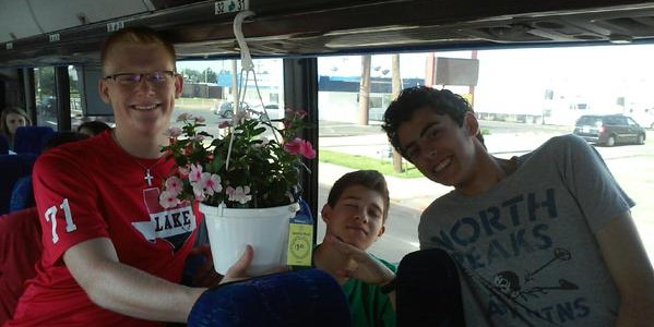 The classiest gents bought flowers for the bus. #f…
